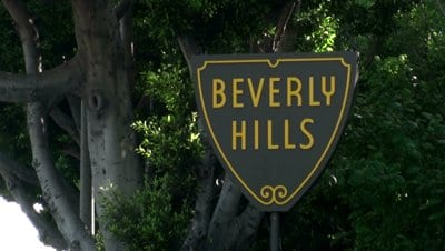 stock-footage-los-angeles-june-beverly-hills-sign-on-sunset-blvd-june-in-los-angeles-california